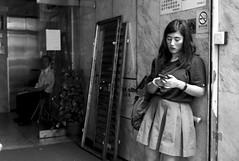 The Watchman, the Gate and the Girl, Mong Kok, Hong Kong (Job Homeless) Tags: people blackandwhite bw streetsnap streetphotography leica life living monochorme monotone m8 hongkong