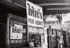 For Rent (35mm) (jcbkk1956) Tags: bangkok thailand street mono blackwhite film 35mm analog contax 167mt ilford pan100 manualfocus carlzeiss 45mmf28 sukhumvitroad sign rent stalls man thai dof worldtrekker