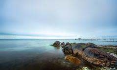 Blue (8000c) Tags: 10stop 10stopfilter aarhus cpl canon1635f4 haida risskov sunwayfoto beach blue cloudy jetty rocks