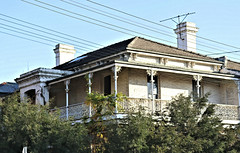 Punt Road Terraces XI - Victoria (IDH Mackinnon) Tags: punt rd road south yarra hill melbourne victoria victorian australia australian aussie 2017 era fading aged historic terrace home house building architecture architectural brick double storey id hearn mackinnon photographer inner city urban design motif lattice wrought iron balcony verandah