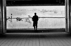 Man in the middle (andersåkerblom) Tags: middle tunnel blackandwhite silhouette man monochrome