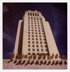 L.A. City Hall 12 (tobysx70) Tags: the impossible project tip polaroid sx70sonar sonar instant color film for sx70 type cameras impossaroid la city hall north spring street dtla downtown los angeles california ca skyscraper highrise government office building blue sky us flags star stripes dtlapolawalk polawalk 061017 toby hancock photography