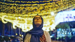 Light that never fades. (► Mo'men Saleh) Tags: portrait makeportraits postthepeople sonya7 sonyalpha minolta 35mm fullframe hijabi hijab bokeh night