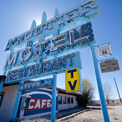 frontier motel. truxton, az. 2015. (eyetwist) Tags: eyetwistkevinballuff eyetwist route66 frontiermotel motel cafe sign truxton arizona square mojavedesert highdesert desert motherroad us66 rt66 road roadsideamerica americana historic vintage classic route 66 faded peeling rusty patina old weathered derelict american west rural nikon d7000 nikkor 1024mmf3545g 1024mm processed postprocessed plugin photoshop alienskinexposure ase type typography americantypologies closed wideangle backlit digixpro neon signgeeks roadtrip landmark typographic tv vacancy payphone bealewagonroad restaurant kingman flagstaff