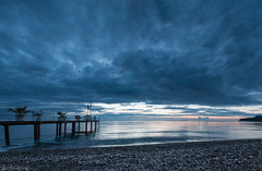 This hour has got the blues! (Anthony P26) Tags: category crystaldeluxe kemer panorama places seascape sunrise travel turkey travelphotography beach pebbles clouds cloudysky morning dawn pier wood iron waves ripples sunlight coast coastal coastline landscape landscapephotography canon canon70d canon1585mm plants sea seaside seashore mediterranean outdoor sky water