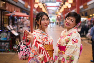 Mother and daughter in kimono in traditional Japanese shopping mall