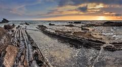 Jagged rocks (stefanogrechi) Tags: longexposure lungheesposizioni sun sole sunset tramonto clouds nuvole rocks scogli blu