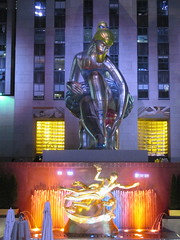 Seated Ballerina Mylar Balloon at Night 6219 (Brechtbug) Tags: seated ballerina mylar balloon night art sculpture by jeff koons 2017 rockefeller center nyc 30 rock new york city standing up above ice rink gold prometheus statue paul manship giant decoration ornaments 05202017 nights nite nites lights lites light oversize load ornament summer spring kids toy kitsch 60s toys sculptures statues pretty evening lobby plaza plant plants plastic artist