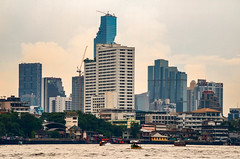 The new rises (21mapple) Tags: bangkok sky skyline skyscraper hotels chaophrayariver water boats thailand