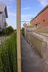 Split Image (brev99) Tags: d610 tamron28300xrdiif tulsa cityscape perfecteffects17 ononesoftware on1photoraw2017 pole restaurant stairs ramp bricks equisetum
