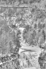 Winter at Letchworth in Black & White (Adventure George) Tags: acdseeultimate blackandwhite blackandwhiteimaging bridge fingerlakes geneseeriver gorge hdr highdynamicrangeimage iceformations landscapes letchworthstatepark march marchsnow monochrome monochromephotography naturalworld nature newyork newyorkstate nikond700 northamerica nystatepark outdoor park photogeorge photoshoot photomatixpro railroad railroadcrossing river rivervalley scenic skylandwater snow snowscene train transportation upstatenewyork us usa water waterfalls westernnewyork winter winterscene unitedstatesofamerica