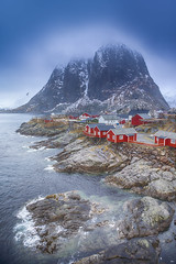 Travel Concepts and Ideas. Traditional Fishing Hut Village in Hamnoy During Early Spring Time in Lofoten Islands, Norway. (DmitryMorgan) Tags: norway norwegian panorama scandinavia arctic bay coast environment europe fjord hamnoy harbor house hut isle light lofoten lofotenislands mountains nature nopeople noone ocean outdoor picturesque polarcircle red reddish reine reinefjord scenery scenic seascape snowy traditional traveldestination travelling village water