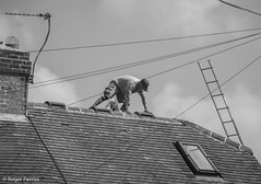 WORKMAN on ROOF, S YORKSHIRE_DSC_3934_LR_2.0-2 (Roger Perriss) Tags: aston roof workman worksoprd tiles ladder ladders chimneys aerials tvaerial telephonewires phonewires window