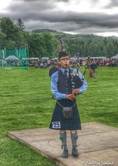Solo Piper (FotoFling Scotland) Tags: highlandgames piper bagpipe blairatholl blairathollgathering blaircastle friend glasses kilt perthshire uniform fotoflingscotland