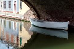 En solitaire (amogiulietta) Tags: alone boat reflections bridge under river nikon po landscape