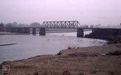 Women cross Kano River in harmattan dust. January 1981