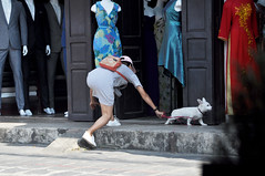 """Come here!"" (Roving I) Tags: girls grabbing runaways dogs dresses pets shops stores stripes suits doorways backpacks moments hoian vietnam"
