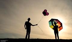 Trading Places (disgruntledbaker1) Tags: disgruntledbaker balloons umbrella sky color
