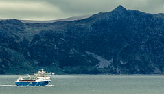 Cape West (John Christian Fjellestad) Tags: norway spring ship ocean cloudy boat mountains sea moody atmosphere coast nature shore