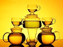Tea for Me (Karen_Chappell) Tags: tea teapot teapots teacup teacups orange yellow glass balance stack beverage liquid stilllife