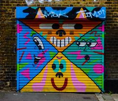 The Happy Garage (Steve Taylor (Photography)) Tags: happy fun smile garage face art graffiti mural streetart colourful uk england london