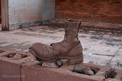 Bootsie (RootsRunDeep) Tags: boot work leather colored stained mine historic wyoming sunrisemine copper iron cinderblock brick inside