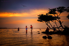 Dancing in the Water at Sunset Beach (JDS Fine Art Photography) Tags: dancing hippies tropical paradise colors vacation fun water happiness beautiful