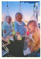 19 serafaina (Rocky's Postcards) Tags: hanging babies bags postcard serafaina emilihrig photo dolls surreal disturbing bungeechord