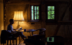 Cozy atmosphere (Erfurt) (Andreas Mezger - Art Photography) Tags: reading book alone cafe bar artificial light daylight open window green dark movie vibrant atmosphere cozy erfurt thüringen