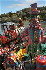 Imperfect Fairground Attractions (Canis Major) Tags: portishead fairground clown dumped modeltrain colourful