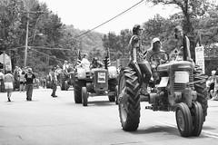 Callicoon Tractor Parade (brianloganphoto) Tags: sullivancounty historical bw americana farmers tractors people newyork farm parade mainstreet monochrome rural callicoon unitedstates us