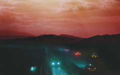 red skies (Coughh_Syrup) Tags: red sky skies clouds sunset orange hue blue road cars night lights neon mountains