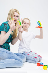 Family Activity Concepts. Mother with Little Daughter Making a Hand Pint Together Indoors.Against White. (DmitryMorgan) Tags: 2 3035 711years active againstwhite artist artistic arty caucasian cheerful child childhood color colorful colour concept craft creative creativity daughter drawing education female fingers fun gouache hand happy kid little messy middleaged mom multicolor paint painter palms parent people playful pleasure positive preschooler smiling tshirt two woman young