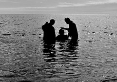 (desbyrnephotos) Tags: god religon baptise christening religious holy ocean sea man woman priest ireland bray wicklow bw blackandwhite nikon desbyrne water reflection