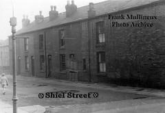 1950s Walkden: Shiel Street (Landstrider1691) Tags: walkden worsley shielstreet 1950s puddles terracedhouses terrace chimneypots slateroof boardedup empty streetlamp lamppost gaslamp