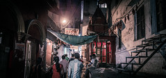 Banaras (Camille Marotte) Tags: 2014 india varanasi street streetphotography night dusk poor decay indian light contrast walk walking group city urban camillemarotte canon sigma texture perspective travel town travelling backpack crepuscule 1dc art panoramic onepoint walls old fabric suspended