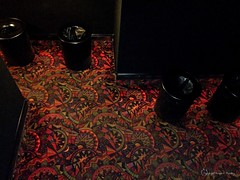 Shhhhh....the movie is starting. Explored 06/14/2017 (Little Hand Images) Tags: carpet colourfulcarpet trashcans trashbins movietheatre indoors dark walls