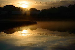 Sunset reflection over a tranquil freshwater lake (Johan Ferret) Tags: atmospheric beauty celestial clouds dawn dusk fiery glow horizon lake mirrored orange orb pond reflection sky sun sunrise sunset surface tranquil water weather