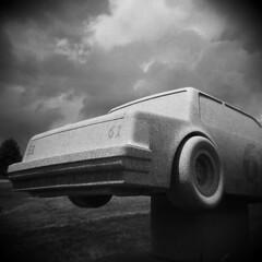 61 (LowerDarnley) Tags: holga barre vermont 61 car racing memorial sky stormy granite carved tire