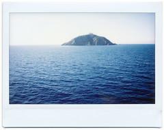 Instax Island (Giorgio Verdiani) Tags: fujifilm instax 100 fujinon 95mm instant istantanea fotografia picture film pellicola elba island isola 2017 mediterranean mediterraneo tirreno sea mare water acqua lighthouse faro seascape paesaggio waves onde