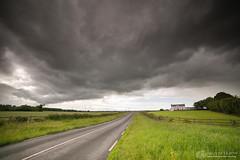 Dark skies on the road to Newgrange (mythicalireland) Tags: clouds dark gloomy sky dramatic grey black landscape house grass road meath ireland
