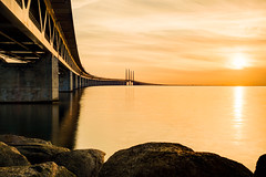 Sunset over Öresund (Karsten Gieselmann) Tags: 1240mmf28 architektur braun brücke em5markii elemente europa exposurefusion gelb gold himmel licht luft mzuiko malmo malmö meer microfourthirds natur olympus oresundbridge photomatix reise schweden sonnenuntergang wolken air architecture brown clouds elements golden kgiesel light m43 mft nature sea sky sunset travel yellow öresundbrücke sweden skane