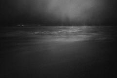 (@wawaweewa) Tags: 35mmfilm analog rollei blackandwhite bnw bw sea lake see ocean seascape oceanscape landscape flashlight nightlights haven horizon haze fog beach nightshot vintage