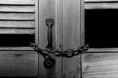 Locked Inside (F051) Tags: bnw blackandwhite blancoynegro chains 50mm 50mmf18 nikon lock locked door vintage sharp