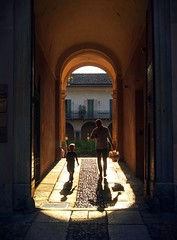 Father and son walking home (PeterThoeny) Tags: varese italy hallway child people walk walking light shadow lightsandshadows town sunset 1xp raw nex6 photomatix selp1650 hdr qualityhdr qualityhdrphotography palazzoestense palace silhouette fav200