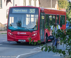 Safer Cycling 2 (M C Smith) Tags: bus red route 313 pavement road houses cars trees green lines white cyclist cycling yellow traffic reflection