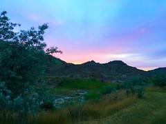 sunset (ekelly80) Tags: montana makoshikastatepark june2017 summer roadtrip keisgoesusa badlands glendive geology scenery sunset sun sky light eveninglight colors pink view campground rocks rockformations layers hills mountains