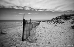 End of the Beach - Explore (mswan777) Tags: fence path sand footprints beach dune grass shore coast lake michigan bridgman scenic shadow monochrome black white d5100 sigma 1020mm cloud sky summer landscape nikon