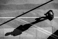 Lines & Shadows (Cliff.j) Tags: barbican street shadows pavement man phone walking lines angle view detail london city bw urban sun above geometry human sony a7 mirrorless people life carl zeiss sonnar 55mm blackandwhite