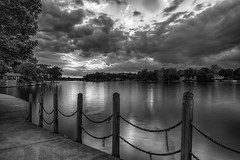 Drama @ Day's End (tquist24) Tags: blackwhite elkhart hdr indiana nikon nikond5300 outdoor stjosephriver bw clouds evening fence geotagged longexposure reflection reflections river sky sunset tree trees water unitedstates